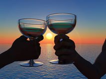 Goblets in hand. Scene goblet in hand on background of the sundown Royalty Free Stock Photos