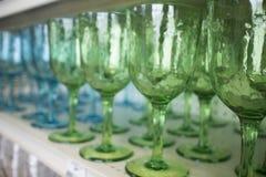 Goblets on shelf Stock Image