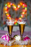 Goblets with sparkling wine and festive toys Stock Images