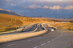 Highway Ganja-Baku on the January evening. GOBUSTAN, AZERBAIJAN - JANUARY 03, 2018: Highway Ganja-Baku on the January evening Stock Photos