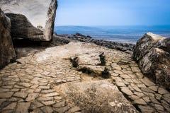 Gobustan national park ancient rocks. Rock path and mountains near Baku in Azerbaijan. Exposition of Petroglyphs in Gobustan near Baku, Azerbaijan royalty free stock photos