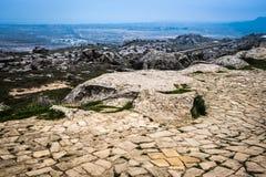 Gobustan national park ancient rocks. Rock path and mountains near Baku in Azerbaijan. Exposition of Petroglyphs in Gobustan near Baku, Azerbaijan royalty free stock images