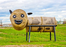 Goby. This sculpture depicts a young bull. The sculpture is made of straw, metal, and other household items. Mounted on the side of the road after the harvest Royalty Free Stock Image