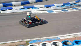 Gocart going fast on circuit Royalty Free Stock Image