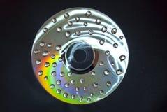 Gocce bagnate del CD Fotografia Stock
