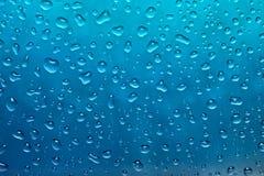 Gocce blu fresche di acqua Immagini Stock Libere da Diritti