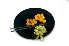 Gocce dei rossi d'uovo dell'oro e rossi d'uovo pizzicati dell'oro, De tailandese antico Immagini Stock