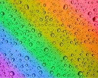 Gocce dell'acqua del Rainbow Immagini Stock