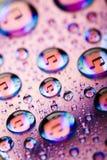 Gocce dell'acqua di musica sul disco fotografia stock