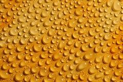 gocce dell'acqua su priorità bassa arancione Fotografie Stock
