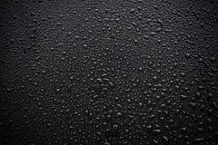 Gocce dell'acqua su priorità bassa nera Fotografie Stock