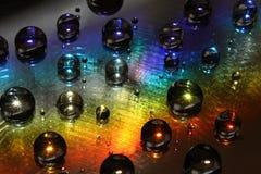 Gocce dell'acqua su vetro incerato fotografia stock