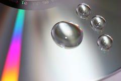 Gocce dell'acqua sul disco Immagini Stock Libere da Diritti