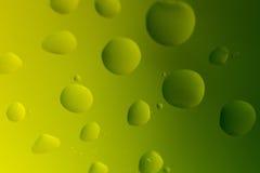 Gocce dell'olio su giallo verde Fotografia Stock Libera da Diritti