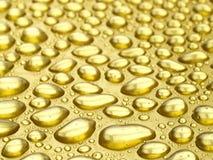 Gocce dell'oro Fotografia Stock
