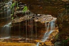Gocce di acqua - cadute della giunzione Immagine Stock