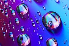 Gocce di acqua e di colori Fotografie Stock