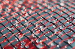 Gocce di acqua e maglia Immagini Stock