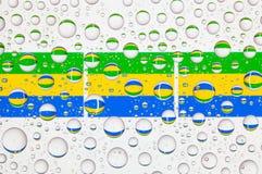 Gocce di acqua su vetro e sulle bandiere del Gabon Fotografia Stock Libera da Diritti