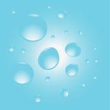 Gocce di acqua sul blu Fotografie Stock