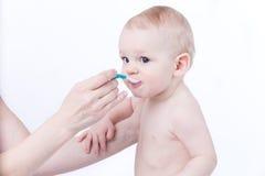 Gocce di cibo del bambino Fotografie Stock
