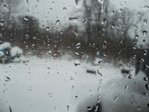 Gocce di pioggia sul vetro Immagine Stock