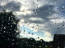Gocce di pioggia sul vetro Fotografia Stock