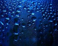Gocce scintillanti blu Fotografia Stock