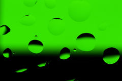 Gocce su verde nero- Fotografie Stock