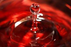 Goccia dell'acqua rossa Fotografia Stock