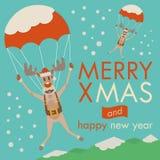 Goccia delle renne di Natale dal paracadute nel giorno Immagini Stock