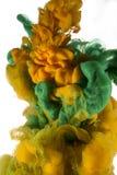 Goccia di colore inchiostro marrone e verde Immagine Stock Libera da Diritti
