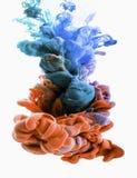 Goccia di colore turchese arancio e scuro Fotografie Stock