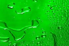 Goccia verde dell'acqua fotografia stock