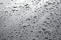 Goccioline di acqua su un'automobile Fotografia Stock Libera da Diritti