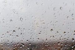 Goccioline di acqua su vetro Fotografie Stock Libere da Diritti