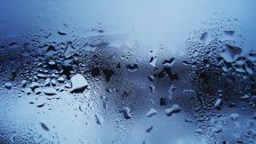 Goccioline di acqua sul vetro Immagini Stock