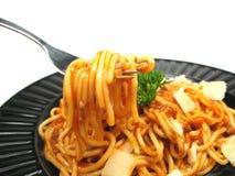 Goce de sus espaguetis Fotos de archivo