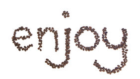 Goce deletreado con los granos de café aislados en blanco Imagen de archivo