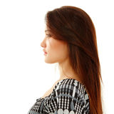 Goce hermoso del perfil de la muchacha adolescente aislado en blanco Imagen de archivo libre de regalías