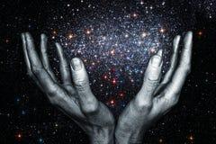 God& x27; 拿着星星系的s手 库存图片