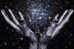 God& x27; 拿着星星系的s手 免版税库存图片