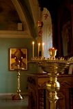 God. Internal furniture of church and burning candles Royalty Free Stock Images