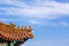 God and animal terracotta at the Chinese traditional roof top. Royalty Free Stock Images