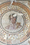 God Apollo. Detail of a second century roman mosaic of the God Apollo (god of sun, light, truth, prphesy and healing). Surrounded by a laurel wreath medallion Royalty Free Stock Photos