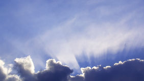 God is Back There!. I love the beams of light emerging from the clouds.  It really looks like god is behind those clouds Royalty Free Stock Photo