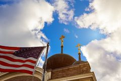 God Bless America American flag church. With blue sky and clouds Royalty Free Stock Photo