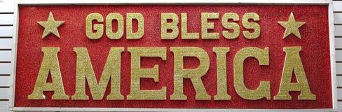 God Bless America Billboard. God Bless America sign written in gold glitter on a red glitter background Stock Images