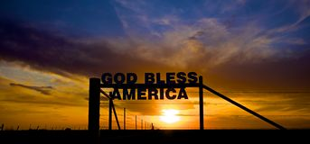 God Bless America. Dramatic Sunset with Sign that reads God Bless America Royalty Free Stock Image