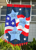 God bless america flag. An independence day flag hanging outside a home Royalty Free Stock Photography